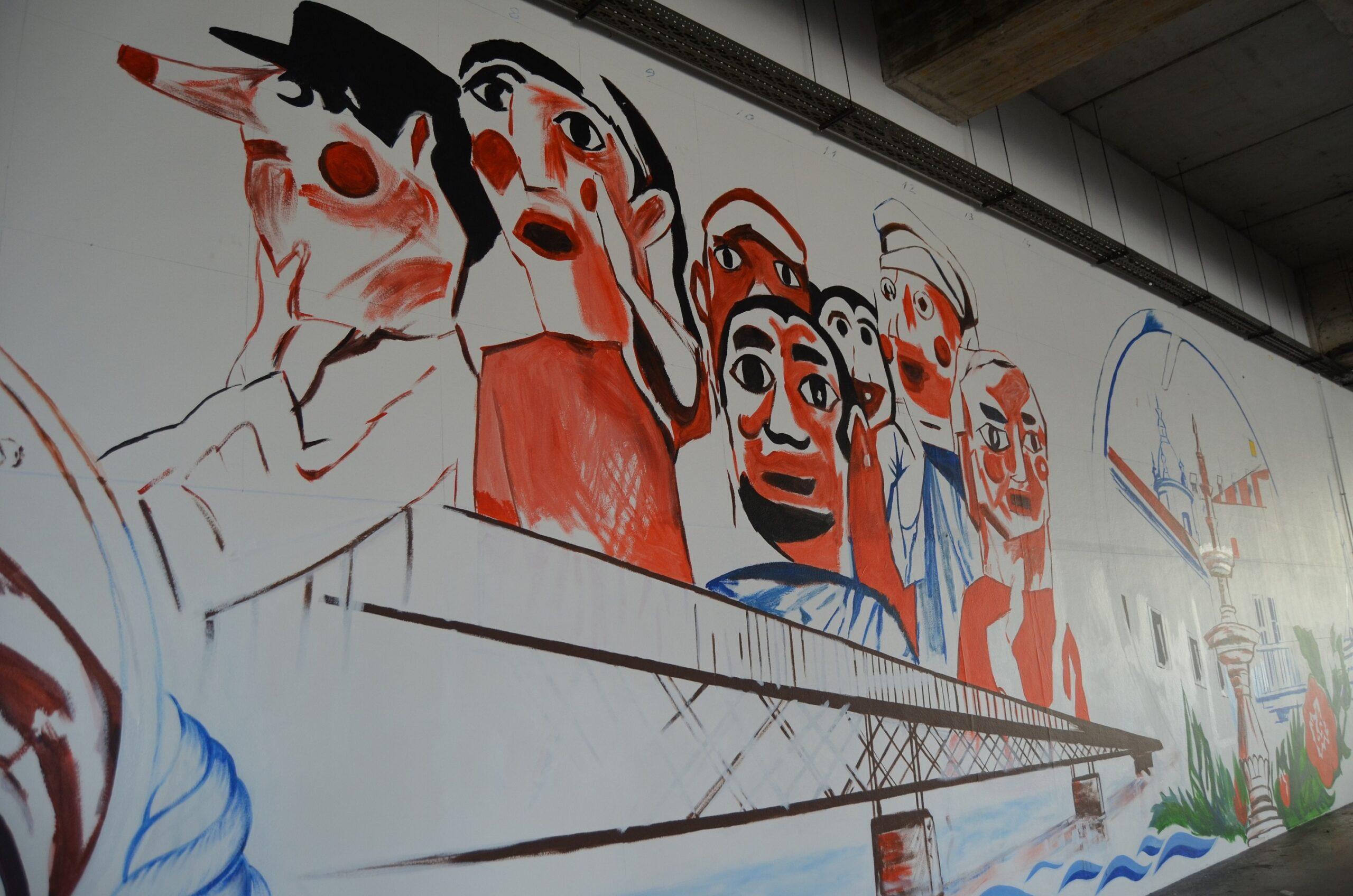 """Mural de 23 metros de Cipriano Oquiniame pintado em Interface de Transportes quer ser """"postal de visita"""" de Viana do Castelo"""